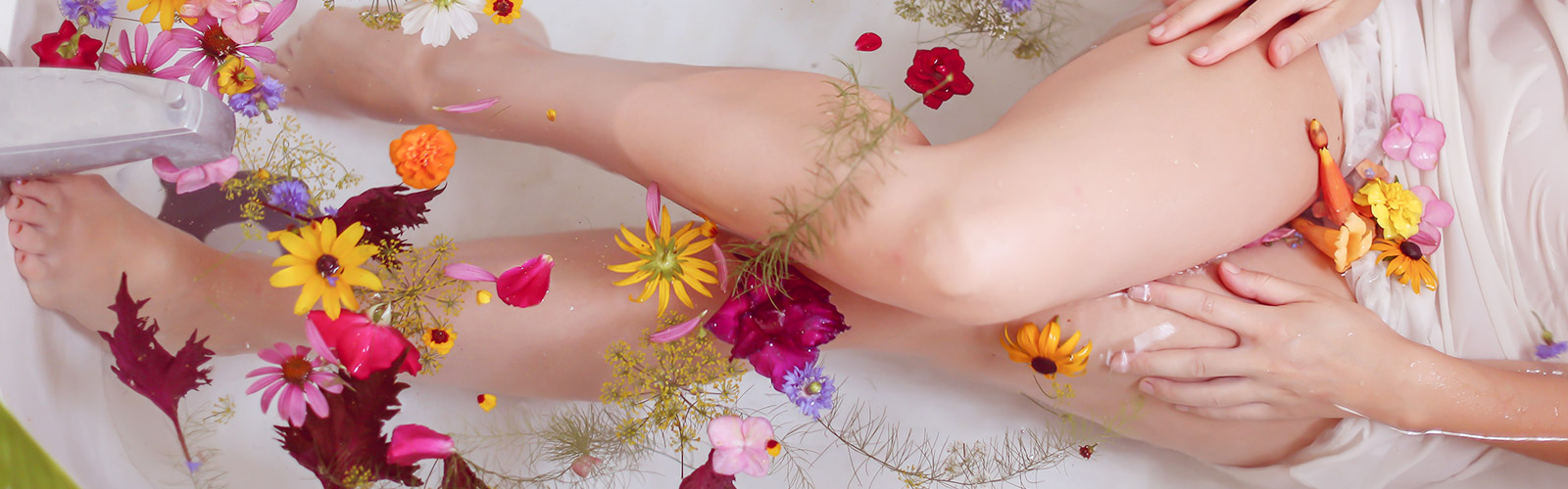 Woman in bath with flower petals