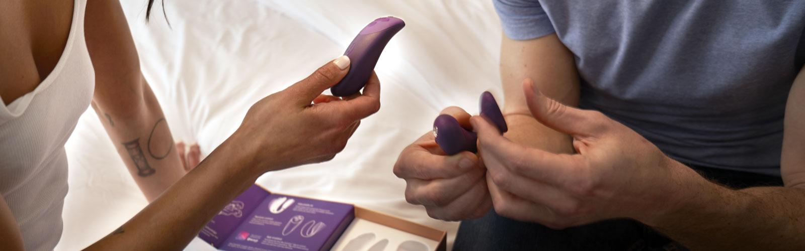 Couple holding vibrator